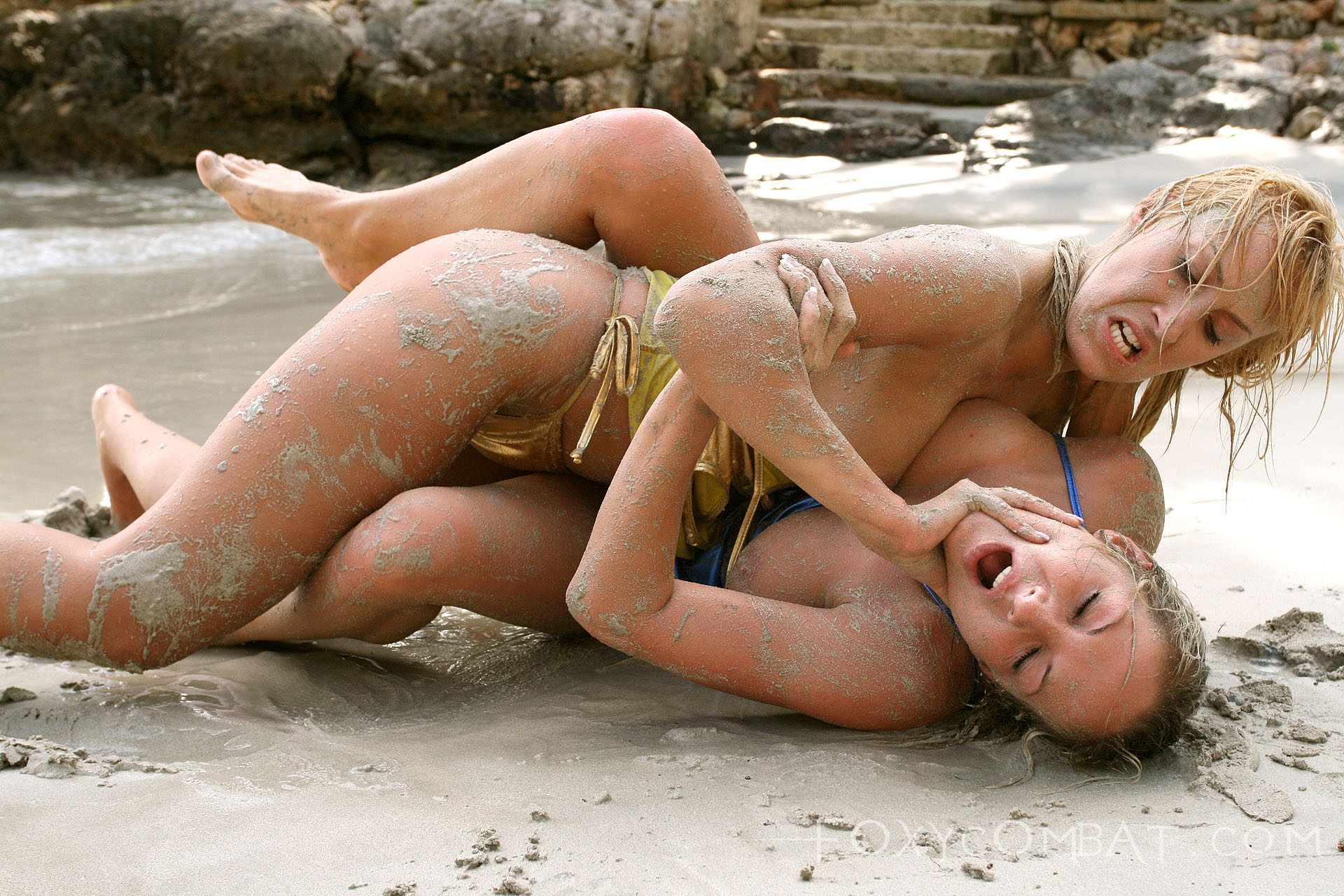 Hot girls wrestling at beach